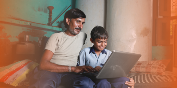 Child and parent with a laptop