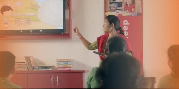A teacher teaching in a smart classroom